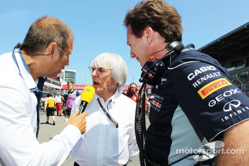 (L naar R): Kai Ebel, RTL TV-presentator met Bernie Ecclestone, CEO Formula One Group, en Christian