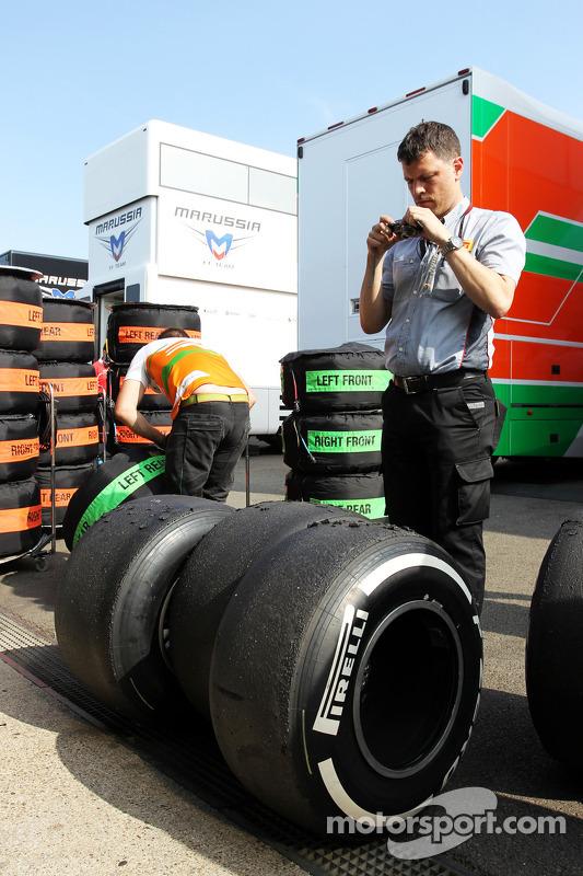 Pirelli Tyre Technician checks Sahara Force India F1 Team Pirelli tyres
