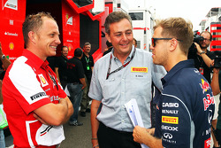(L to R): Daniele Tartoni, Ferrari, with Mario Isola, Pirelli Racing Manager and Sebastian Vettel, Red Bull Racing