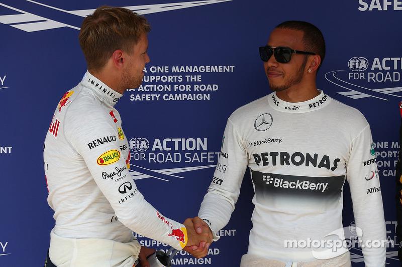 Sebastian Vettel, Red Bull Racing and Romain Grosjean, Lotus F1 E21