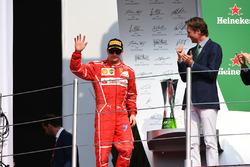 Third place Kimi Raikkonen, Ferrari celebrates on the podium