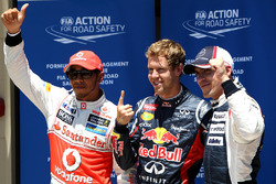 Top three qualifiers Sebastian Vettel, Red Bull Racing, Lewis Hamilton, McLaren, and Pastor Maldonado, Williams F1 Team