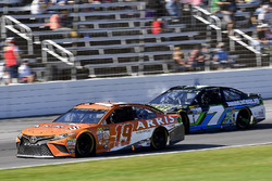 Daniel Suarez, Joe Gibbs Racing Toyota and Joey Gase, Tommy Baldwin Racing Chevrolet