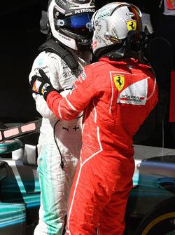 Race winner Sebastian Vettel, Ferrari and Valtteri Bottas, Mercedes AMG F1 celebrate in parc ferme