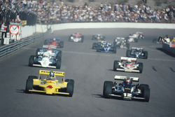 Mario Andretti, Penske PC9, Johnny Rutherford, Chaparral, at the start of the race