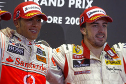 Lewis Hamilton, McLaren MP4-24 Mercedes and Fernando Alonso, Renault R29 celebrate on the podium