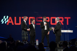 Lando Norris and George Russell on stage