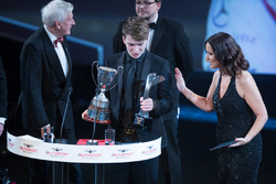 McLaren Autosport BRC Award winner Dan Ticktum on stage with John Fitzpatrick
