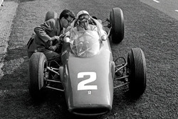 John Surtees, Ferrari 156, talks with Ferrari Chief Designer Mauro Forghieri