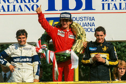 Podium: race winner Alain Prost, McLaren, second place Nelson Piquet, Brabham, third place Ayrton Senna, Lotus