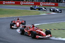 Rubens Barrichello, Ferrari F2004 leads team mate Michael Schumacher, Ferrari F2004