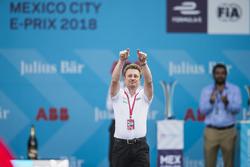 Allan McNish, Team Principal, Audi Sport Abt Schaeffler, celebrates on the podium