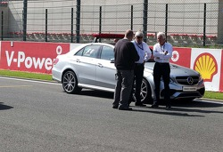 Charlie Whiting, FIA Delegate has a look at the groves on the grid.