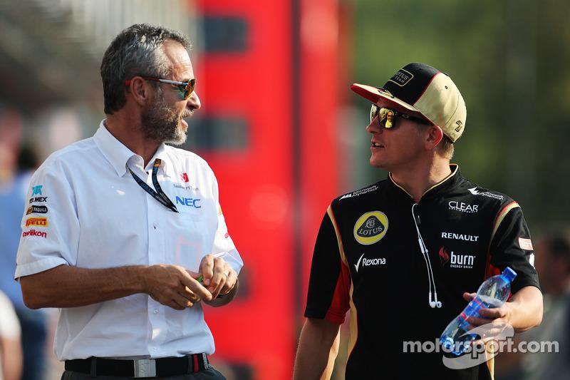 Beat Zehnder, Sauber F1 Team Manager with Kimi Raikkonen, Lotus F1 Team
