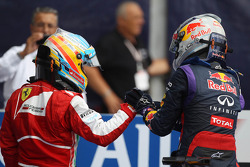 (L to R): Fernando Alonso, Ferrari congratulates race winner Sebastian Vettel, Red Bull Racing in parc ferme