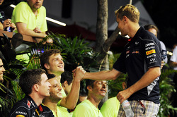 Race winner Sebastian Vettel, Red Bull Racing celebrates with the team
