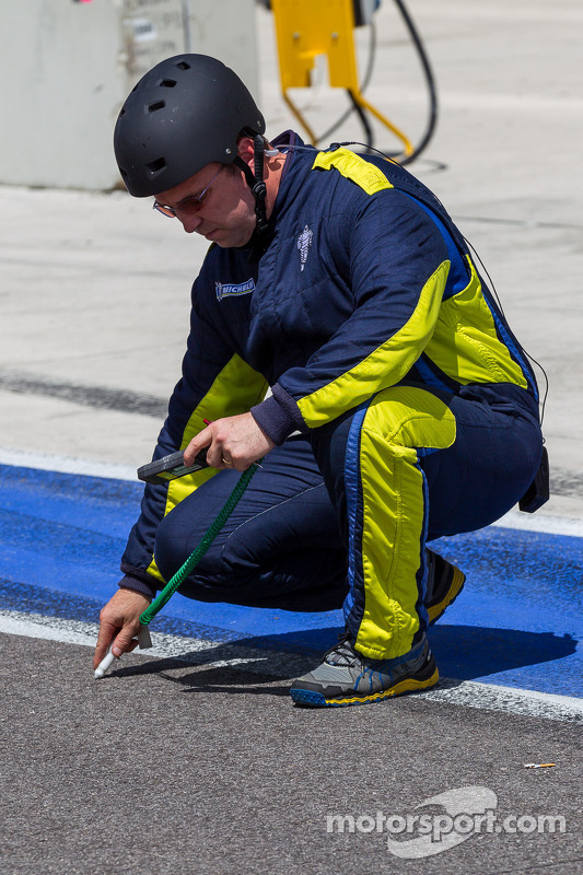 Tire engineer checking track temperature