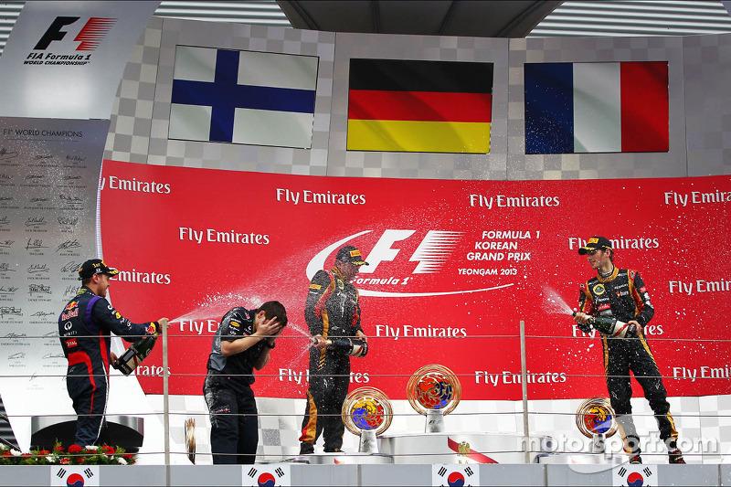 Race winner Sebastian Vettel, second place Kimi Raikkonen, third place Romain Grosjean
