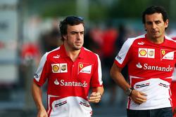 (L to R): Fernando Alonso, Ferrari with Pedro De La Rosa, Ferrari Development Driver