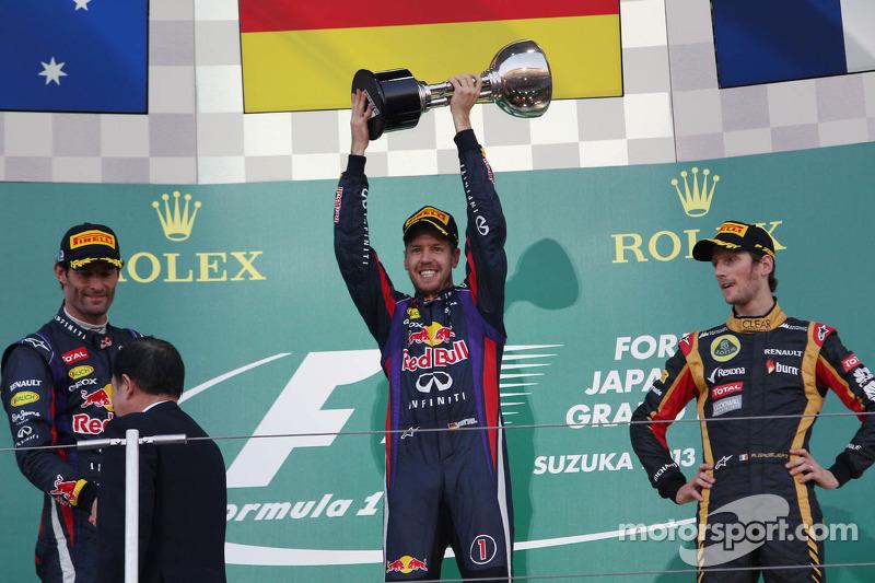 The podium: Mark Webber, Red Bull Racing, second; Sebastian Vettel, Red Bull Racing, race winner; Ro