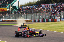 Mark Webber, Red Bull Racing RB9 as team mate Sebastian Vettel, Red Bull Racing RB9 runs wide