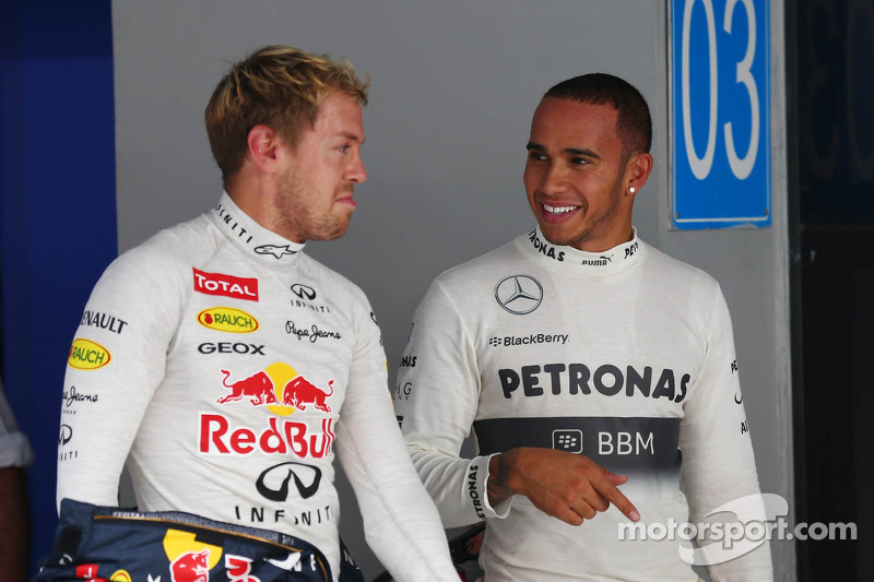 (L to R): Pole sitter Sebastian Vettel, Red Bull Racing with Lewis Hamilton, Mercedes AMG F1 in parc ferme