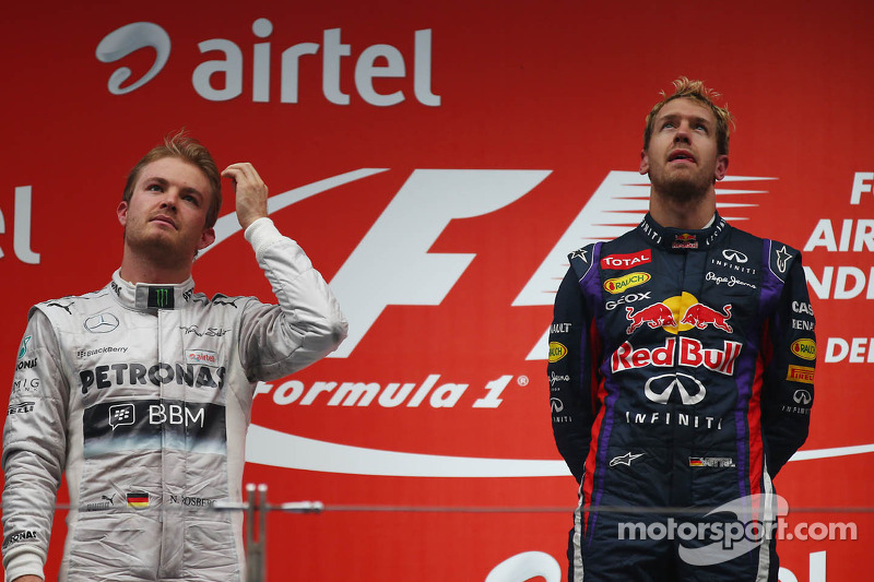 Podio: ganador de la carrera y capeón del mundo 2013 Sebastian Vettel, segundo lugar Nico Rosberg y tercer lugar Romain Grosjean
