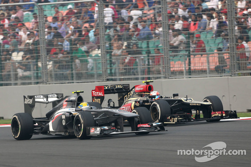 Esteban Gutierrez, Sauber F1 Team and Romain Grosjean, Lotus F1 Team
