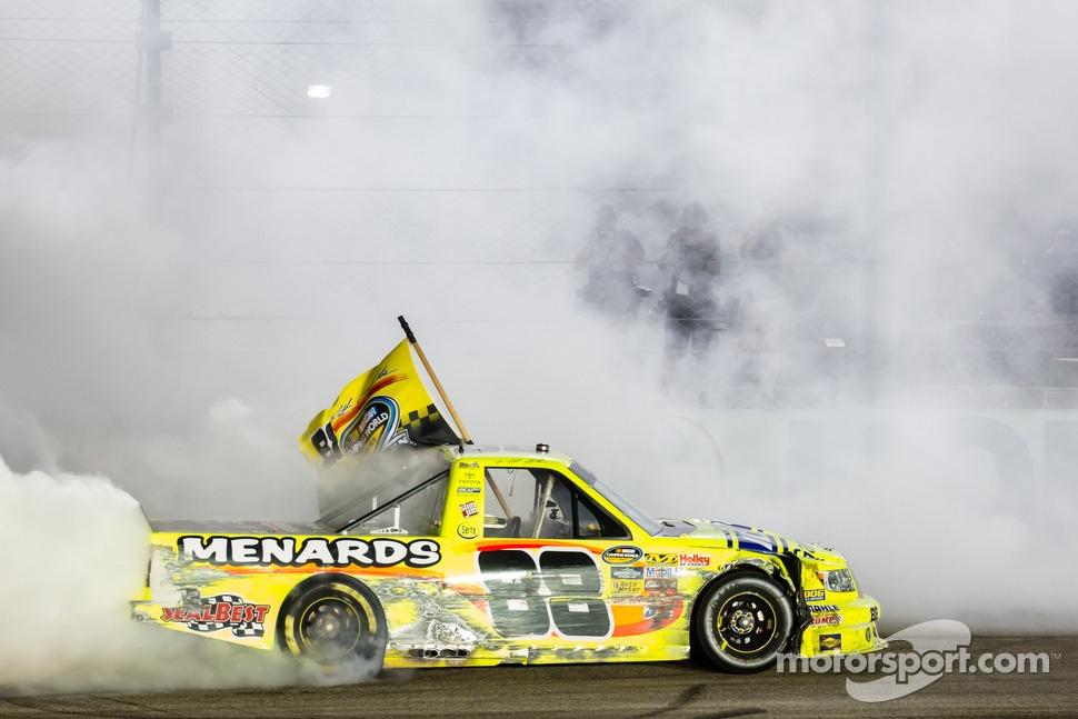 NASCAR Camping World Truck Series 2013 champion Matt Crafton celebrates