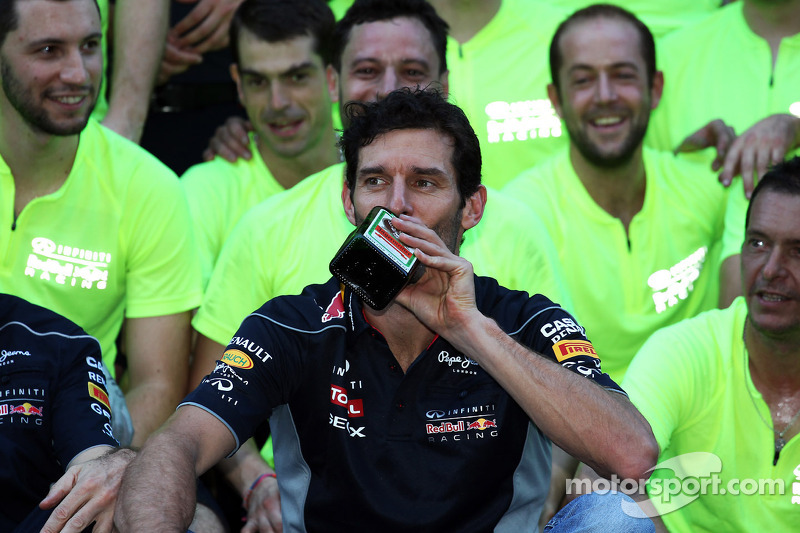 Mark Webber, Red Bull Racing with a bottle of Jagermeister at the team celebration