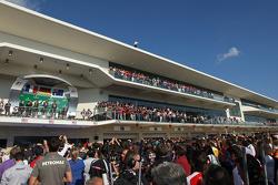 The podium, Lotus F1 Team, second; Sebastian Vettel, Red Bull Racing, race winner; Mark Webber, Red Bull Racing, third