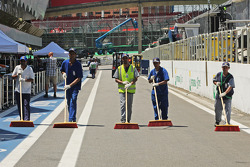 The pit lane is sweeped