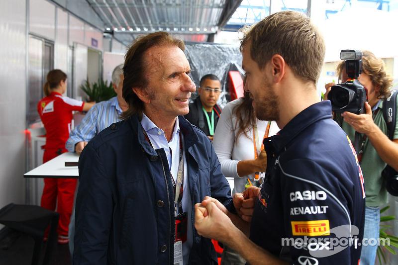(L naar R): Emerson Fittipaldi, met Sebastian Vettel, Red Bull Racing