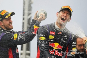 Mark Webber, Red Bull Racing celebrates his second position and final GP on the podium with team mate Sebastian Vettel, Red Bull Racing