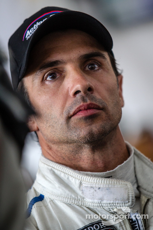 End of the race tension: Christian Fittipaldi watches the last lap of the race