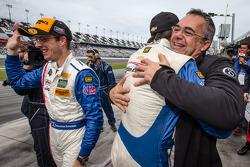Race winners Christian Fittipaldi and Sébastien Bourdais celebrate with Fabien Giroix