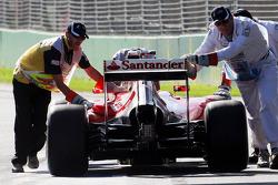 Kimi Raikkonen, Ferrari F14-T is pushed down the pit lane