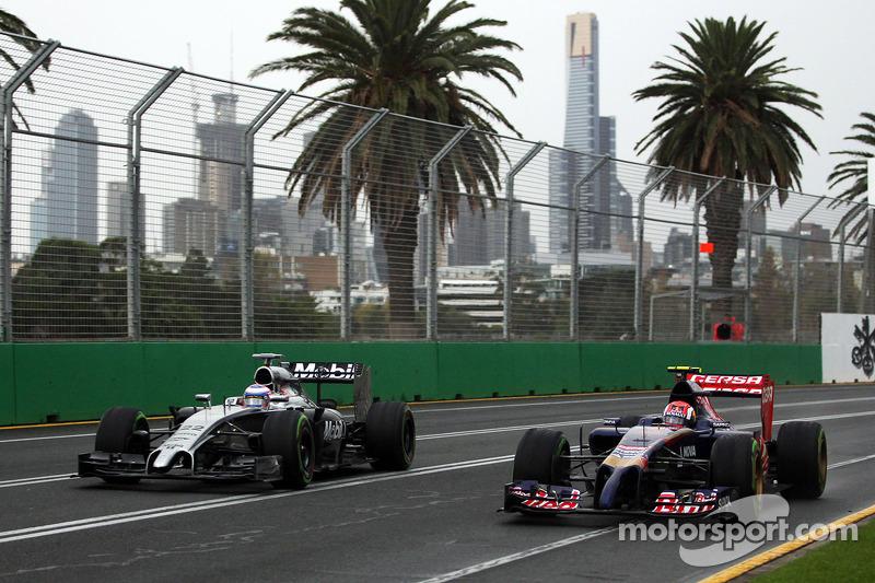 (L to R): Jenson Button, McLaren MP4-29 and Daniil Kvyat, Scuderia Toro Rosso STR9