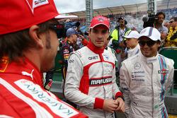 (Da sinistra a destra): Fernando Alonso, Ferrari con Jules Bianchi, Marussia F1 Team e Felipe Massa, Williams alla parata dei piloti