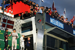 The podium, Red Bull Racing, second; Nico Rosberg, Mercedes AMG F1, race winner; Kevin Magnussen, McLaren, third; Alan Jones (AUS)