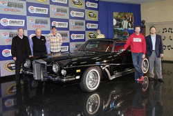 Rick Hendrick, Dale Earnhardt Jr. and Ray Evernham pose for a photo with Elvis' 1973 Stutz Blackhawk