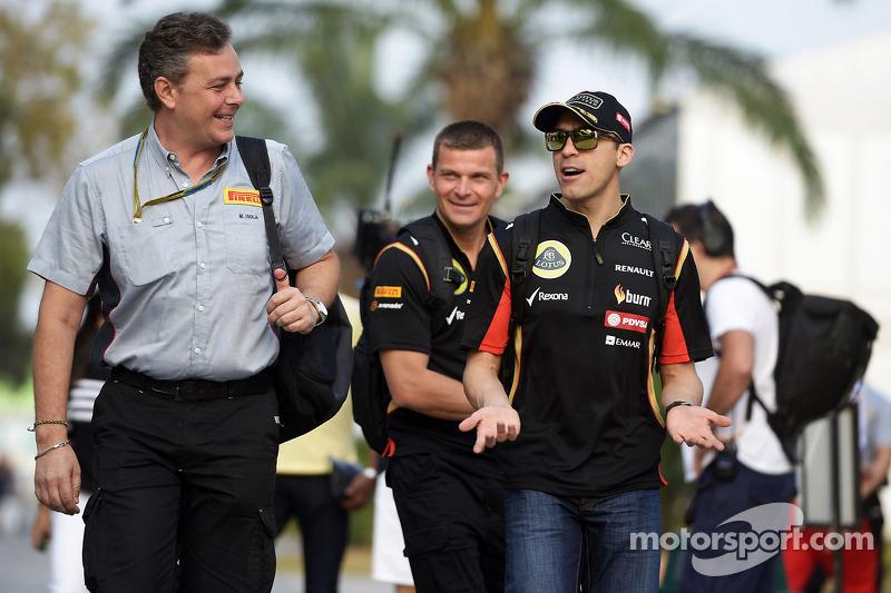 (L to R): Mario Isola, Pirelli Racing Manager with Pastor Maldonado, Lotus F1 Team