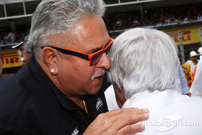 (L to R): Dr. Vijay Mallya, Sahara Force India F1 Team Owner with Bernie Ecclestone, on the grid