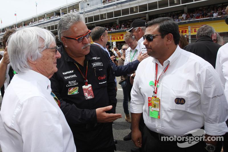(L to R): Bernie Ecclestone, with Dr. Vijay Mallya, Sahara Force India F1 Team Owner and Farhan Vohr
