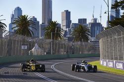 Valtteri Bottas, Mercedes AMG F1 W09, passes Carlos Sainz Jr., Renault Sport F1 Team R.S. 18