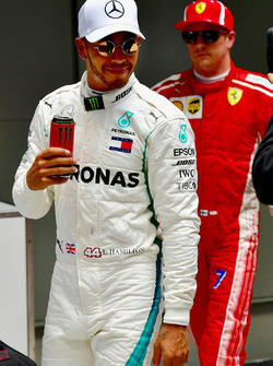 Pole sitter Lewis Hamilton, Mercedes-AMG F1 celebrates in parc ferme with a can of Monster