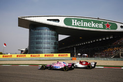 Sergio Perez, Force India VJM11 Mercedes, leads Charles Leclerc, Sauber C37 Ferrari