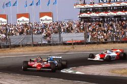 Gilles Villeneuve, Ferrari 126CK followed by Jacques Laffite, Ligier JS17 Matra and John Watson, McLaren MP4/1 Ford.