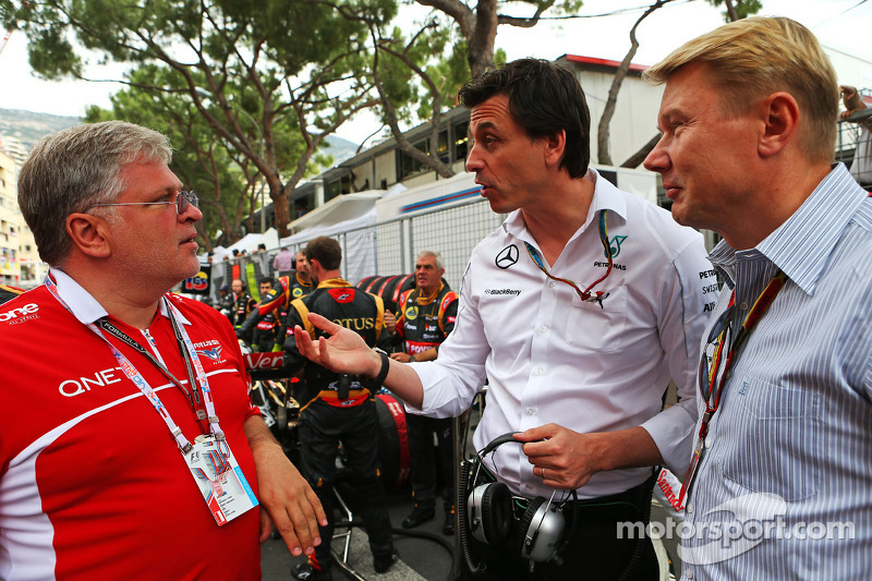 (L to R): Andrei Cheglakov, Marussia Team Owner on the grid with Toto Wolff, Mercedes AMG F1 Shareho