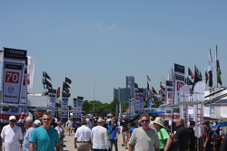 Fans explore the paddock